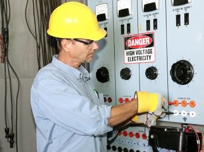 Tri-City Electric industrial electrician working with high voltage.